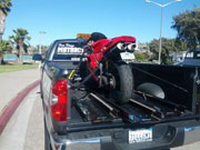 Motorcycle Tow - pickup truck rear view